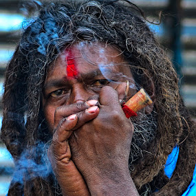 Addiction by Chiradeep Mukhopadhyay - People Portraits of Men ( baboo ghat, kolkata, sadhu )