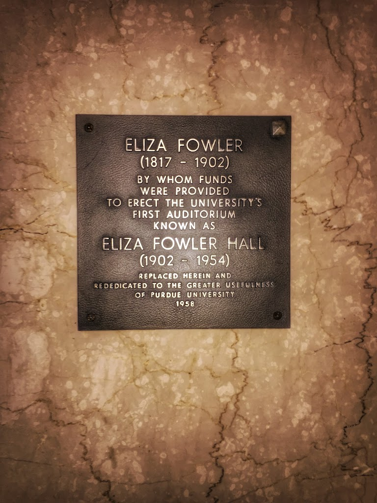 ELIZA FOWLER (1817 - 1902) BY WHOM FUNDS WERE PROVIDED TO ERECT THE UNIVERSITY'S  FIRST AUDITORIUM KNOWN AS ELIZA FOWLER HALL (1902 - 1954) REPLACED HEREIN AND DEDICATED TO THE GREATER USEFULNESS OF ...
