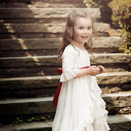 Stairwell of Innocence by Joseph Humphries - Babies & Children Child Portraits ( lensflare, brown eyes, one light setup, stairs, beautiful, innocence, white dress, children, smile )