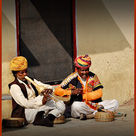 The Snake Charmers by Prasanta Das - People Musicians & Entertainers ( snake, charmers, bin )