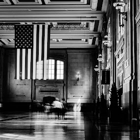 Ghostly Pedestrians by Travis Wessel - Black & White Buildings & Architecture ( union station, train station, black and white, american flag )