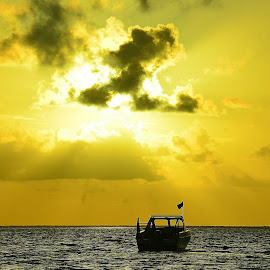 waving flag by Shreya Bansal - Novices Only Landscapes ( clouds, water, flag, sunset, sea, yellow, boat )