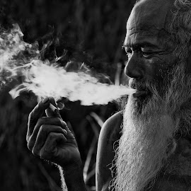 why? by Vijay Tripathi - People Portraits of Men ( potrait, villagers, black and white, street, candid, travel, people, heritage, artwork, smoke, life, village, smoking, beard, old man, senior citizen, fisherman, classic )