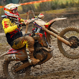 On One Wheel by Marco Bertamé - Sports & Fitness Motorsports ( uphill, one wheel, bike, mud, rainy, motocross, motorcycle, clumps, race, competition )