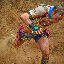 Escaping The Spash Bomb ! by Marco Bertamé - Sports & Fitness Other Sports ( water, differdange, splash, splatter, 2015, soup, waterdrops, running, luxembourg, muddy, strong, drops, brown, strongmanrun, man )