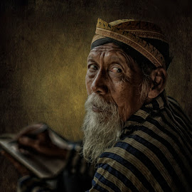 Write the history by Indrawan Ekomurtomo - People Portraits of Men