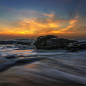 Dawn by Ravikanth Kurma - Landscapes Sunsets & Sunrises ( orange, dawn, sea, long exposure, beach, kovalam, rocks, sun, chennai )