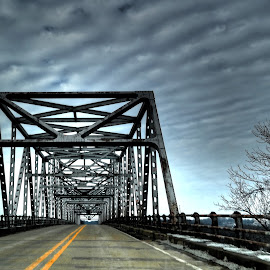 crossing the bridge by Fraya Replinger - Buildings & Architecture Bridges & Suspended Structures ( clouds, yellow lines, driving, cloudy, bridge )