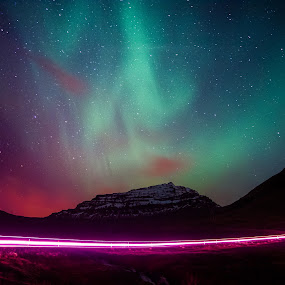 The Lights at Night by Derek Kind - Landscapes Starscapes ( clouds, icelandic, car, hills, mountain, aurorae, northern lights, aurora, aurora borealis, star, car trails, eastfjords, road, island, mountains, iceland, stars, 2012, light trails, long exposure )