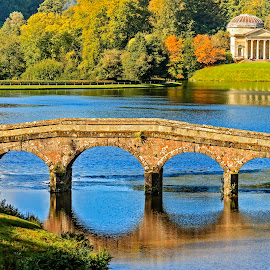 Stourhead Garden Wiltshire UK by Graham Mulrooney - Buildings & Architecture Bridges & Suspended Structures ( water, structure, building, uk, england, stourhead, stourhead gardens, horizontal, buildings, plants, trees, lake, bridge, garden, structures )