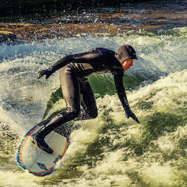 Surfing in the city by Robert Manea - Sports & Fitness Surfing ( ride, athletics, splash, sports, travel, recreation, adventure, surfing, nature, surfer, action, power, surf, motion, man, water, cool, extreme, spray, male, sea, fun, outdoor, wave, summer, athletic )