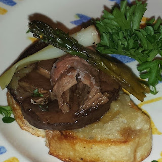 Steak and Mushroom Crostinis topped with grilled scallions and asparagus