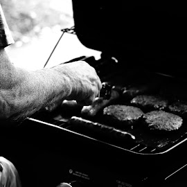 Grilling by Joe Spandrusyszyn - Food & Drink Cooking & Baking ( sausage, grill, black and white, hot dog, bw, arm, hamburger, man, grilling,  )