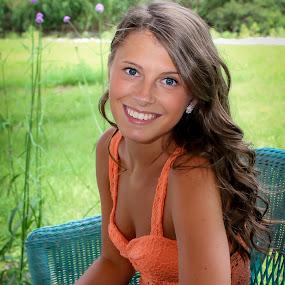 by Emily Schmidt - People High School Seniors ( blue chair, orange, high school, senior photo, long brown hair, portrait )