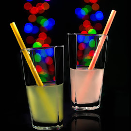 sparkles by Muhannad Salem - Artistic Objects Glass ( black background, shallow, straw, juice, drink, blurr, glass, pink, dof, yellow, bokeh, black,  )