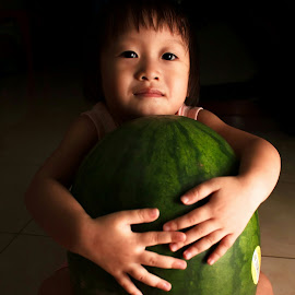 Watermelon by Wing Yin Cheong - Babies & Children Child Portraits ( naughty, hug, low key, asia, embrace, children, watermelon, cute )