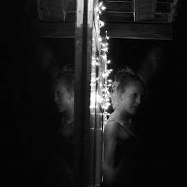 Backed Up Against a Wall by Savannah Eubanks - Black & White Portraits & People ( reflection, symmetry, night, dark, woma, lights )
