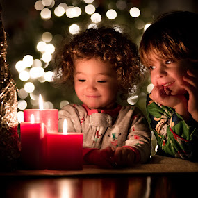 Candlelight Christmas by Mike DeMicco - Public Holidays Christmas ( pajamas, eve, xmas, christmas, children, kids, siblings, cute, glow, bokeh, love, candle, sweet, happy, candles, light )