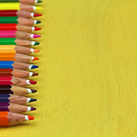 A row of pencils on yellow background  by Dipali S - Artistic Objects Education Objects ( copy space, wood, spectrum, office supply, colors, school supplies, art, white, writing instrument, education, business, multi colored, pencil, heap, macro, pattern, vibrant color, pencil drawing )