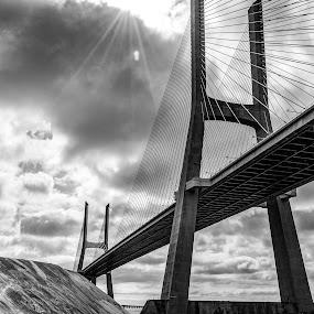 The bridge is a walk to the other side. by José Borges - Buildings & Architecture Bridges & Suspended Structures ( clouds, bw, lisbon, bridge, portugal, sun, grafiti, river,  )