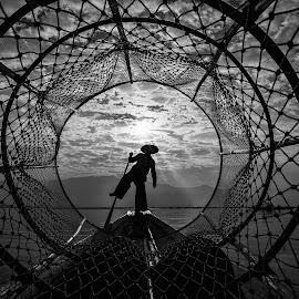 Inlee Fisherman by Indrawaty Arifin - Black & White Portraits & People ( fishermen, fish trap, backlight, lake, boat,  )