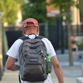Walking Away by Thomas Shaw - People Portraits of Men ( walking, ball cap, cap, jeans, white, bottle, gray, skin, hat, hand, red, blue, backpack, belt, arms, tee shirt, man, black )