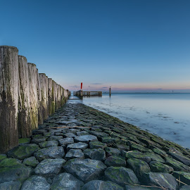 Earlybird @Breskens, NL by Tim Delmoitie - Landscapes Waterscapes ( sunset, long exposure, seascape, poles, rocks )