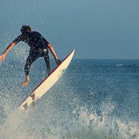 Surfer in Flight by Jeannine Jones - Sports & Fitness Surfing