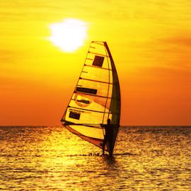 Sailing at sunset by Yuval Shlomo - Uncategorized All Uncategorized ( sunrise, ocean, sunset, sailing, sun, sea )