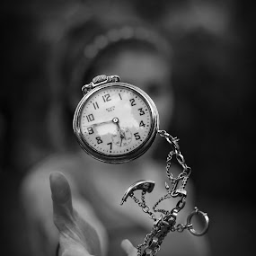 Teaching Time to dance (B&W) by Kyle Re - Black & White Macro ( dancing, animated, highspeed, detail, unique, black and white, moment, beauty, contrast, hand, macro, pocket watch, time, girl, details, focsu, watches, creative, clock, watch, clocks, peopl, chain, female, outdoor, outdoors, outside, intricate,  )
