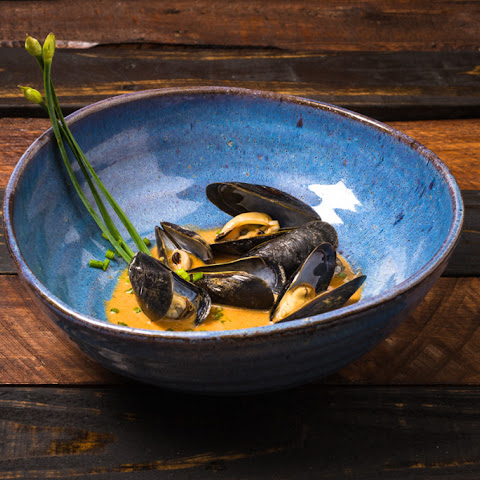 Sake Steamed Mussels in a Thai Red Curry Sauce