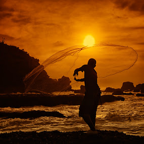 I Cast My Net into the Sea by Lucky E. Santoso - People Fine Art ( pwcsilhouettemotion, sunset, sea, beach, net, fisherman )