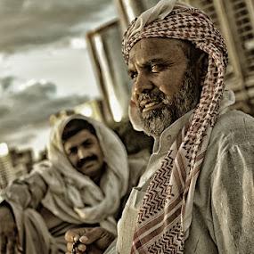 Unloading by Ronald Romero - People Portraits of Men