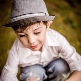 Crouching boy, hidden buggies by Joanna Cox Kilgore - Babies & Children Child Portraits ( sitting, crouching, shy, boy, bug hunter, hat )