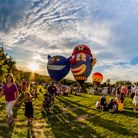 End of Balloon Show by Nancy Merolle - News & Events Entertainment ( clouds, long shadows, sky, balloon show, propane, event, sundown, hot air balloons, crowd, people, shadows, , Earth, Light, Landscapes, Views )