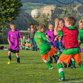He Kicks...He Scores by Garry Dosa - Sports & Fitness Soccer/Association football ( orange, ball, purple, green, boys, outdoors, action, children, net, running, goal, soccer )