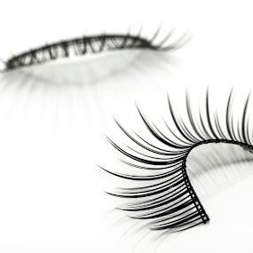 false eyelashes isolated on white by Tanawat Pontchour - Artistic Objects Other Objects ( nobody, face, fashion, plastic, adhesive, applicator, makeup, beauty, long, close, glamour, mascara, girl, accessory, woman, lifestyle, cosmetics, care, fake, black, closeup, eye, ridiculous, abstract, isolated, decoration, beautiful, white, fun, human, up, vogue, femininity, fashionable, female, color, facial, background, cosmetology, make, eyelash )