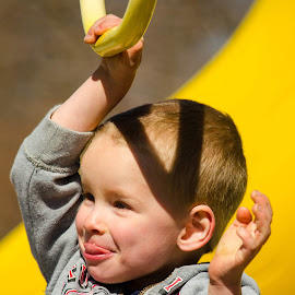 Ben trying out the rings. Karen was there to catch him . by Wilma Michel - Babies & Children Toddlers
