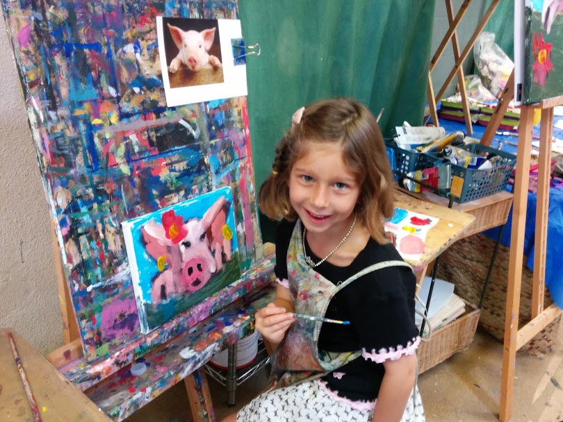 Student working on her 'Piggy' painting