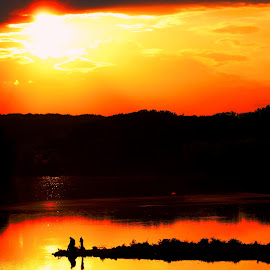 Sun Down by Cecilia Sterling - Landscapes Sunsets & Sunrises ( clouds, silhouette, sunset, lake, people )