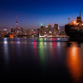 Skyline Ship by Ralph Sobanski - City,  Street & Park  Skylines ( skyline, canada, skyscrapers, ship, toronto, colors, ontario, lake, colours, lights, lake ontario, long exposure, night, reflective )