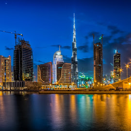 Business Bay - Dubai by Karim Eldeghedy - City,  Street & Park  Skylines ( reflection, dubai, bay, reflections, long exposure, bay bridge, burj khalifa, city at night, street at night, park at night, nightlife, night life, nighttime in the city )
