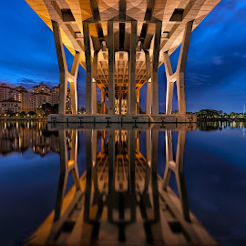Under the Bridge by Gordon Koh - Buildings & Architecture Bridges & Suspended Structures ( clouds, building, reflection, park, riverfront, architecture, cityscape, city park, singapore, modern, urban, modern city, movement, asia, long exposure, symmetry, bridge, homes, tanjong rhu city, river )
