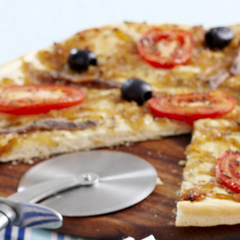 Crispy Pizza with Caramelized Onions, Anchovies, Tomatoes and Olives
