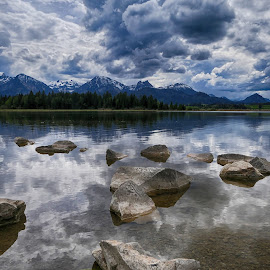 Hopfensee near Füssen by Christiane Baur - Landscapes Waterscapes ( clouds, mirror, water, reflection, mountains, cloudy, sea, lake, stormclouds, cloudporn, hopfensee, alps )