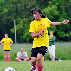 Yellow Soccer Girl by Kevin Pastores - Sports & Fitness Soccer/Association football ( ball, kick, strike, girl, player, cleats, grass, sports, intense, youth, flow, soccer )