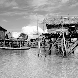 by Alvin Ngow - Landscapes Travel ( b&w, moods, freedom, black and white, bw, children, landscape, fishing village, water house, photography, borneo, asian, sabah, island, life, sky, village, nature, poverty, transport, family, semporna, asia, bajau laut, gypsies, travel locations, water, houses, drying, sea, tourism, malaysia, seascape, boat, relaxing, waterscapes, fishing boat, holiday, wooden, outdoor, background, sea gypsy, sampan, island hopping, bridge, landscapes, mood factory,  )