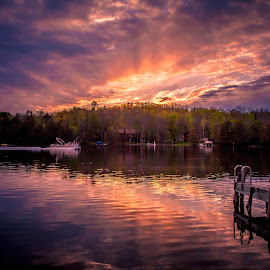 A Sunset on a Minnesota Lake by Gary Hanson - Landscapes Waterscapes ( minnesota, big thunder lake, 10000, sunset, sunrays, lakes, dock, remer )