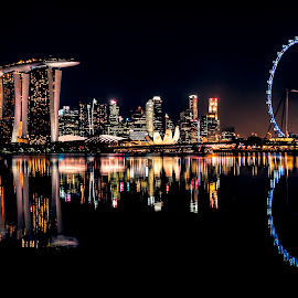 Rare moment of rest by Gordon Koh - City,  Street & Park  Skylines ( skyline, reflection, marina bay sands, still, travel, singapore, urban, tourist, iconic, skyscraper, ferries wheel, asia, mbs, singapore flyer, night, famous landmark, art science museum, hotel, waterfront, asm )
