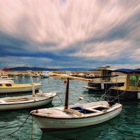 Anchored by Ljiljana Cviljak - Transportation Boats ( clouds, sky, fishing boats, color, anchored, boats, landscape, the harbor, the sea )